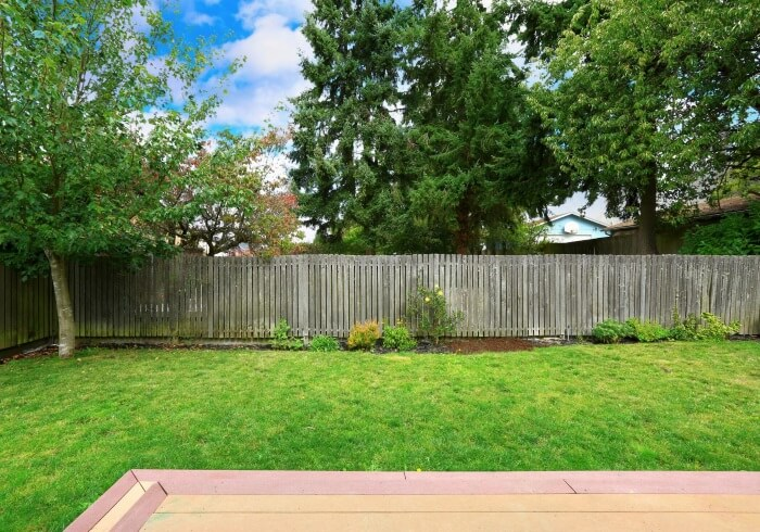 This photograph shows the backyard of a beautiful Paterson home after a commercial fencing installation