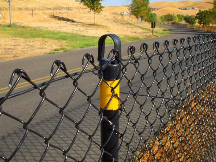 Paterson Fence Installation finishes a chain link fence for a happy custoemr