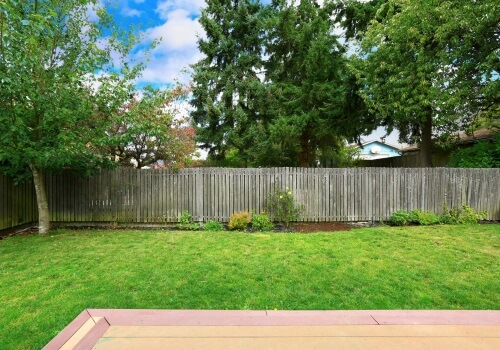 This photograph shows the backyard of a home after a residential fencing project in Paterson